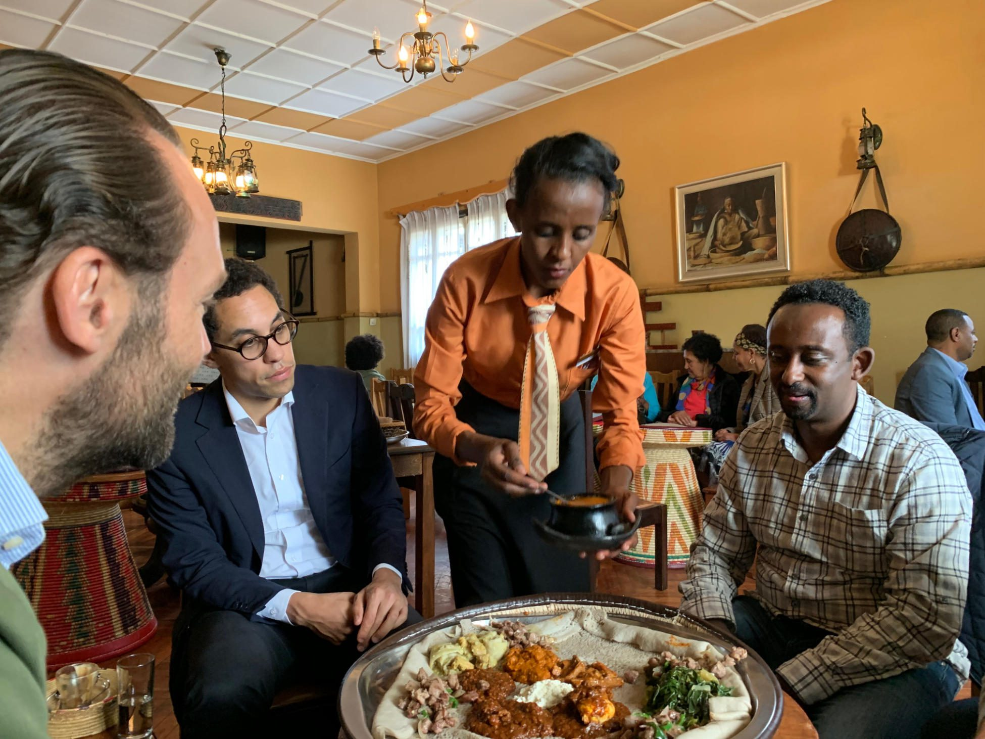Adiamseged Eyassu, General Manager of Rockstone Ethiopia and Benjam Vetterli, Country Head, Rockstone Ethiopia, share a meal with Dietrich Rogge, Founder of Rockstone